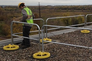 Roof Safety Rail System Protects Workers During Maintenance and Repair